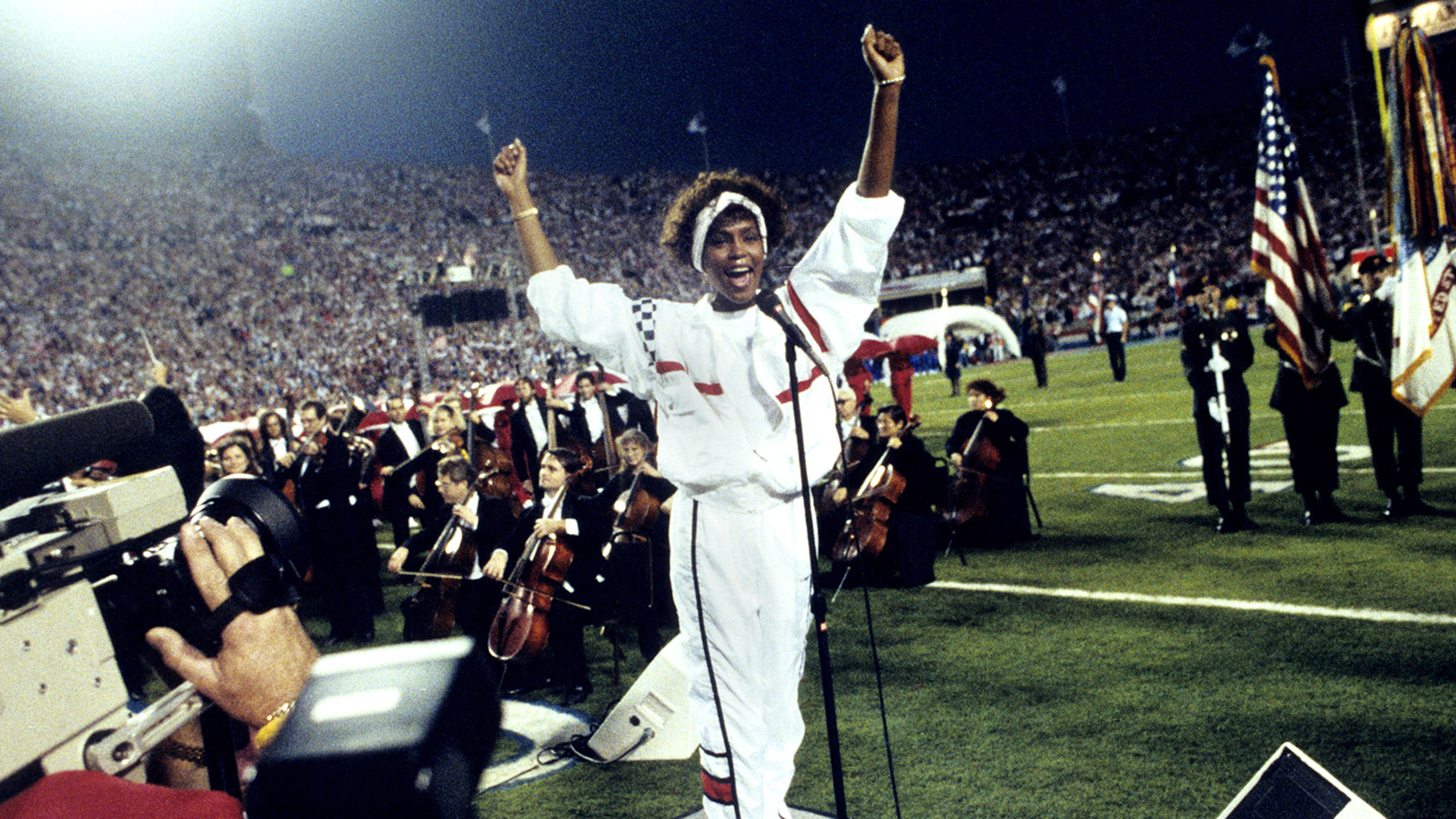 Singer Whitney Houston sings the National Anthem before a 20-19 New Giants wino ver the Buffalo Bills at Super Bowl XXV on January 27, 1991 at Houlihan's Stadium in Tampa Bay, Florida.  (Al Messerschmidt via AP)